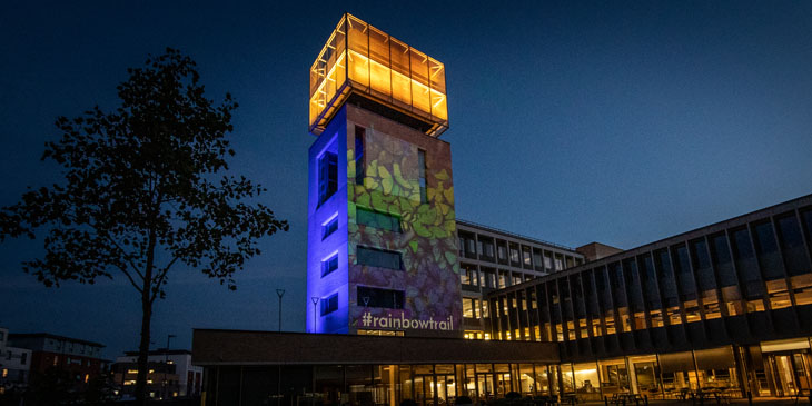 The Tower at our international headquarters lit up in blue with a quote by Stephen Hawking projected on to it in white