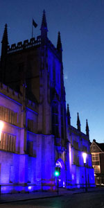 200 year old Pitt Building on Silver Street in Cambridge lit up in blue lights
