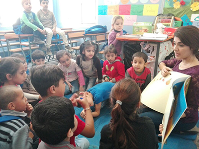 Working with Refugees Syrian refugee children enjoy a reading activity in Lebanon