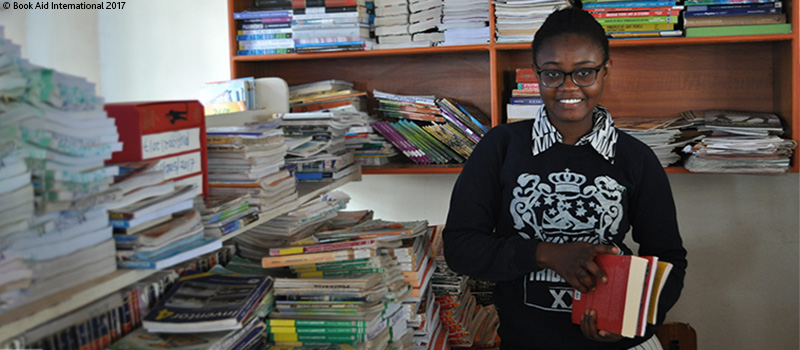 Yvonne from a Kenyan refugee camp with books
