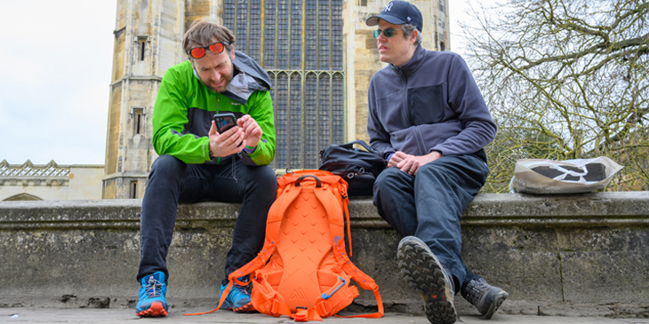James Ketchell and Mark Woods Nunn sat on a wall in front of kings college chapel in Cambridge in the United Kingdom